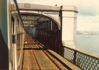 Entering the central section of the Tay Bridge headed towards Dundee one fine spring morning in 1980 [see image 33615].<br><br>[David Panton&nbsp;01/04/1980]