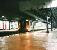 156 435 stands at Platform 3 with a southbound service on a wet evening in February 1998<br><br>[David Panton&nbsp;/02/1998]