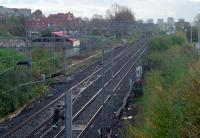 Looking east from Dalmuir station to the former Up Refuge Siding in 1989. This was taken out of use as part of the Yoker re-signalling scheme. In the middle distance the line crosses over the Glasgow, Yoker and Clydebank Railway (out of sight to the left) which also burrowed under the Forth and Clyde Canal.<br><br>[Ewan Crawford&nbsp;//1989]
