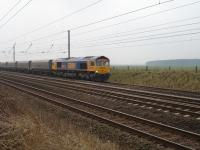 66711 on First GBRF Drax Power Station to Tyne Dock empty northbound working passes Shipton north of York at 10.35 on 25 Mar '10 just after loaded working passed heading south<br><br>[David Pesterfield&nbsp;25/03/2010]