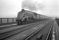 View north over the King Edward Bridge towards Newcastle in the 1960s with mist hanging over the city and the River Tyne. Kings Cross A4 no 60029 <I>Woodcock</I> has just left Central station with a southbound train and is now heading for home.<br><br>[K A Gray&nbsp;//]