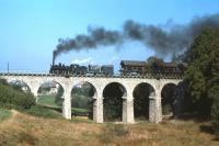 Scene on the Waldviertelbahn in Lower Austria in October 1985, close to the then Czechoslovakian border, as 760mm gauge 0-8+4 no 399.03 (of �'Stutztender' construction on the Engerth principle) crosses the viaduct at Weitra with train 71445, the 10.12 freight from Gmuend to Gross Gerungs. In the event the train did not reach its destination as the loco failed at Langschlag. By this date the line was nominally dieselised (except for weekend passenger workings during the summer which reverted to steam as a tourist attraction) but a shortage of diesels on this and other Austrian State Railways n.g. lines meant that one freight diagram was often still steam worked.<br><br>[Ingrid Jamieson&nbsp;04/10/1985]