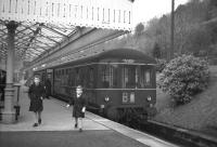 A pair of young enthusiasts (aka the photographer's sons) about to leave Peebles station off the 0744 Edinburgh - Peebles - Galashiels DMU on 3 February 1962, the last day of passenger services over the line. <br> <br><br>[Frank Spaven Collection (Courtesy David Spaven)&nbsp;03/02/1962]