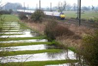 The up <I>'Flying Scotsman'</I> hurries past flooded fields on the approach to Tollerton, approximately 10 miles north of York, on 25 March 2010.<br><br>[John Furnevel&nbsp;25/03/2010]