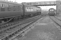 A train for Wick departs Georgemas Junction in July 1963 behind a BRCW Type 2 locomotive.<br><br>[Colin Miller&nbsp;/07/1963]