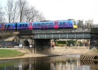 A nice day for a stroll along the north bank of the river on 21 March 2010, just as the 1347 Scarborough - Liverpool Lime Street First TransPennine Express service crosses the Ouse on the eastern approach to York station.<br><br>[John Furnevel&nbsp;21/03/2010]