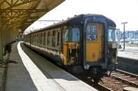 In their original form, the Class 309 'Clacton' EMUs had attractive wraparound windscreens, but they offered drivers little protection against impacts from bricks and other missiles that vandals were apt to hurl at trains in the 1970s. The windows were remodeled, detracting from the overall appearance, in the late 1970s. Shown here is an unrebuilt example waiting to leave Clacton on 3rd July 1977. [See image 40041]<br><br>[Mark Dufton&nbsp;03/07/1977]