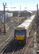 334 008 passes Ayr TRSMD on 19 March with an Ayr - Glasgow Central service.<br> <br><br>[Bill Roberton&nbsp;19/03/2010]