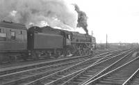 Britannia Pacific no 70044 <I>Earl Haig</I> takes the 12.05 Glasgow Central - Birmingham New Street out of Carlisle in April 1963.<br><br>[K A Gray&nbsp;12/04/1963]