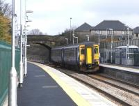 156 437 pulls into Dunlop with a Kilmarnock service on 17 March 2010. It is only 3 months since restoration to a double track station took place here and everything is still looking pristine. <br> <br><br>[David Panton&nbsp;17/03/2010]