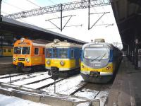 Three colourful generations of EMU stand at the buffer stops at Gdansk Glowny station in March 2010.<br> <br><br>[Colin Miller&nbsp;08/03/2010]