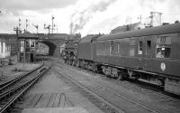 One of the St Rollox batch of BR Caprotti class 5s no 73149 takes a Dundee train out of Buchanan Street in 1964<br><br>[K A Gray&nbsp;//1964]