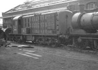 Prototype BR mixed-traffic diesel-electric locomotive no 10800 in a siding at Derby Works on 27 August 1960. NBL built 10800 was ordered by the LMS in 1946 but did not appear until 1950 following nationalisation. Intended as a replacement for steam on secondary branch lines (pre-Beeching) orders for a total of 54 similar locomotives were placed in 1955 (eventually becoming the short-lived BR classes 15 and 16). [See image 2884]<br><br>[K A Gray&nbsp;27/08/1960]