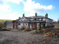 The former Dalmellington Iron Co Company Store, latterly a pub, adjacent to the station, photographed on 4 April 2010. Rail served at one time by a siding running along the nearside, there is now a pile of rotting sleepers at the end of the path.<br> <br><br>[Colin Miller&nbsp;04/04/2010]