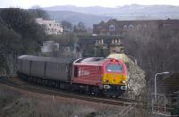 DB Schenker liveried 67018 lifts the evening Fife circle service away from Inverkeithing on 5 April 2010.<br> <br><br>[Bill Roberton&nbsp;05/04/2010]