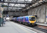 TransPennine 185 112 nearly ready to depart Platform 10 at Waverley on 24 March. Its journey to Manchester Airport will not conspicuously involve crossing the Pennines, though it will have a fair stab at the less celebrated Southern Uplands. <br> <br><br>[David Panton&nbsp;24/03/2010]