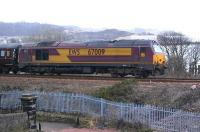 67009 climbs away from Inverkeithing with an unidentified train on 5 April, following some 15 minutes behind the scheduled Fife Circle service [See image 28383] .<br><br>[Bill Roberton&nbsp;05/04/2010]