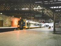 158 705 in Scotrail Express livery stands at Perth platform 4 in February 1998 with an Edinburgh to Inverness service. [See image 28501]<br><br>[David Panton&nbsp;/02/1998]