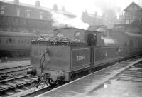 A Lancashire scene from the late 1950s with Aspinall ex-L&Y 2-4-2T no 50850, dating from the 1890s, waiting in the rain at Bolton  with a local train on 7 April 1959. (Bolton station, opened by the MB&B in 1838, carried the suffix 'Trinity Street' between 1910 and 1954). The locomotive, which was a resident of nearby 26C at the time, was eventually withdrawn from Southport shed at the end of 1961. <br><br>[Robin Barbour Collection (Courtesy Bruce McCartney) 07/04/1959]