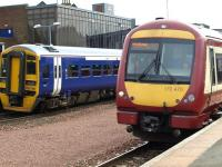 Passing trains at Larbert station on 9 April 2010.<br><br>[Brian Forbes&nbsp;09/04/2010]