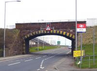 The bridge carrying the line over the A77 at the north end of Girvan station is to be replaced. The project is planned to be completed over 5 days with demolition of the current structure scheduled to commence on 16 April. The bridge is seen here looking east on 9 April 2010. [See image 28605]<br><br>[Colin Miller&nbsp;09/04/2010]
