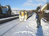 The 0926 Carlisle - Leeds train arrives at Dent Station on 9 January 2010. Trains ran very well over the snowy period which lasted about 5 weeks, although the evening train back on this particular day did lose time due to having to creep through Blea Moor tunnel as a result of giant icicles!<br> <br><br>[Peter Rushton 09/01/2010]