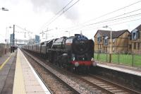 Britannia Pacific 70013 <I>Oliver Cromwell</I> leaving Lockerbie with <I>The Great Britain III</I> after taking on water in the loop south of the station.<br><br>[John Gray&nbsp;09/04/2010]