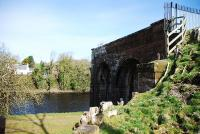 The remains of Tongland Viaduct on the Kirkcudbright Branch. There were stone piers in the river and the viaduct was of girder construction. The remains of the piers are in the field just beyond the arches in the picture. April 2010.<br><br>[John Gray&nbsp;10/04/2010]