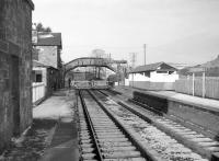 View north along the platforms at Fountainhall towards the level crossing in 1965. The station house stands to the left of the footbridge.<br><br>[Robin Barbour Collection (Courtesy Bruce McCartney)&nbsp;//1965]