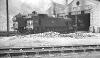 An August 1960 scene in the Welsh valleys with residents 5516 and 6644 standing outside 86C Aberbeeg shed.<br><br>[K A Gray 12/08/1960]