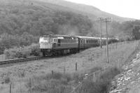 A Fort William - Glasgow train between Roy Bridge and Tulloch in July 1963 with a BRCW Type 2 in charge.<br> <br><br>[Colin Miller&nbsp;/07/1963]