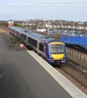 On 14 April 170 416 pulls into Leuchars with one of the hourly Dundee to Edinburgh semi-fast services.� These trains are a fairly recent addition to the hourly Aberdeen services and have doubled the number of daytime services here, as well as doubling the work (or at least the lever-pulling) of the signalman in the box in the background. <br> <br><br>[David Panton&nbsp;14/04/2010]