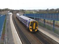 Hoping to influence the local rail traveller, a candidate for the <br> Dunfermline & West Fife seat in the General Election has placed some <br> placards in the field adjoining Queen Margaret station.� Meanwhile 158 731 pulls in on its first stop on a Cowdenbeath to Newcraighall service.� It has just passed, beyond the disused overbridge, the rusty loops at Townhill Junction, busy with Longannet coal trains until 2 years ago when the reopening of the Alloa line obviated the need for a lengthy detour and and some shunting.<br><br>[David Panton&nbsp;14/04/2010]