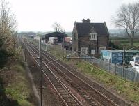 Milnthorpe station was over a mile from the small town it served and by 1964 had a service of only three up and four down trains on weekdays. It closed on 1 July 1968, the same day as the stations at Tebay and Shap. The station building survives alongside the WCML as seen in this view looking south towards Carnforth. [Railscot note to would be photographers: The bridge overlooking Milnthorpe is on a fast road with no footpath and not a place to linger waiting for trains. The bridges at Elmsfield, around a mile south of here on the B6384, are a much better location.] <br><br>[Mark Bartlett&nbsp;17/04/2010]