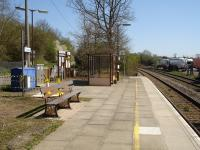 Shipton Station on the Cotswold Line looking along the up platform towards Oxford, with modern waiting shelter and platform bench incorporating the GWR legend in the cast legs. Work is currently in progress between the rear of the bench and the entrance gate. <br><br>[David Pesterfield&nbsp;17/04/2010]