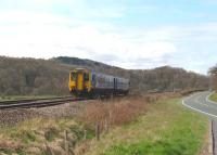 A Carlisle - Newcastle service formed by 156480 runs parallel to the A69 road approaching Haydon Bridge station on 18 April 2010.<br><br>[John Steven&nbsp;18/04/2010]