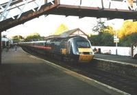 An Aberdeen to London GNER 125 pulls into Inverkeithing one teatime in early October 1998.� The contemporary equivalent of this train still runs (at April 2010) - two operators on.� The footbridge which frames the picture has since been removed and replaced with a more substantial structure at the other end of the platform.� Today the station look more businesslike.<br><br>[David Panton&nbsp;/10/1998]