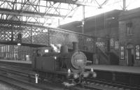 Ex-LMS <I>Jinty</I> no 47326 probably spent as much time as any locomotive under the roof at Carlisle. Seen here taking a break from station pilot duties during a quiet period in July 1965 the 0-6-0T was finally withdrawn by BR from Upperby shed at the end of 1966.<br><br>[K A Gray&nbsp;31/07/1965]