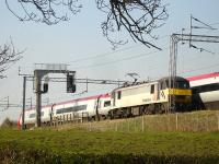 Freightliner 90047 being passed by a Pendolino on 22 April whilst approaching a stop signal south of Winsford Station. <br><br>[David Pesterfield&nbsp;22/04/2010]