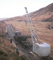A young DS watches the track of the Callander & Oban line retreat slowly but steadily northwards at the northern end of Glen Ogle in December 1966.<br> <br><br>[Frank Spaven Collection (Courtesy David Spaven)&nbsp;/12/1966]