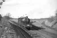 Class D34 4-4-0 no 62471 <I>Glen Falloch</I> approaching Kirkbank station on the Jedburgh branch with the BLS <i>Scott Country Railtour</i> on 4 April 1959.<br><br>[Robin Barbour Collection (Courtesy Bruce McCartney)&nbsp;04/04/1959]