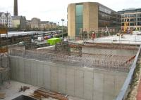 View west from Haymarket on 29 April 2010, showing construction work on the deck over the north side of the car park that will carry part of the tram interchange. Off to the right is  Haymarket Terrace while over on the left are the station platforms, where the East Coast 0952 Aberdeen - Kings Cross HST has just arrived. [See image 28745]<br> <br><br>[John Furnevel&nbsp;29/04/2010]