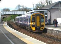 158707 carrying the nameplate <I>Far North Line 125th anniversary</I> on a Perth to Edinburgh service arriving at Inverkeithing on 30 April 2010.<br> <br><br>[Brian Forbes&nbsp;30/04/2010]