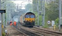 66204 with a westbound container train passing a Network Rail track team on the approach to Birmingham International station on 28 April 2010.<br> <br><br>[John McIntyre&nbsp;28/04/2010]