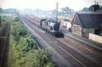 40574 takes a train through Lochside station bound for Glasgow in the summer of 1959. The station had been closed to passenger traffic 4 years earler but was subsequently reopened in 1966. The name Lochside was changed to Lochwinnoch in May 1985.<br><br>[A Snapper (Courtesy Bruce McCartney)&nbsp;21/08/1959]