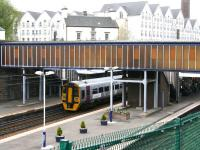 A mid-morning Edinburgh Waverley - Dunblane service makes its first scheduled stop as it draws to a halt at Haymarket's platform 4 on 29 April 2010.  <br><br>[John Furnevel&nbsp;29/04/2010]