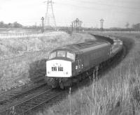 Class 45 no 118 on the Niddrie North to Niddrie West curve with a special train of empty Carflats, presumably from Bathgate to the Midlands, on 4th February 1970.<br> <br><br>[Bill Jamieson&nbsp;04/02/1970]