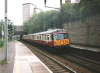 Freshly re-liveried 303 019 with a Lanark to Dalmuir service stands alongside the Down Mainline platform at Motherwell on 2 July 1997<br><br>[David Panton&nbsp;02/07/1997]