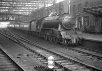 Gresley V2 2-6-2 no 60816 about to to take the 0825 Crewe - Perth train north out of Carlisle on 28 December 1963.<br><br>[Robin Barbour Collection (Courtesy Bruce McCartney)&nbsp;28/12/1963]