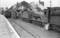 The south east corner of St Boswells in the summer of 1958, with J38 0-6-0 no 65934 and J36 0-6-0 no 65316 on shed alongside the station's bay platform. [See image 17121]<br><br>[Robin Barbour Collection (Courtesy Bruce McCartney)&nbsp;15/07/1958]
